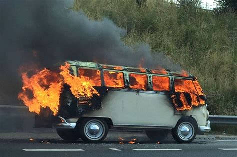 Pictured: Moment VW camper van bursts into flames on busy