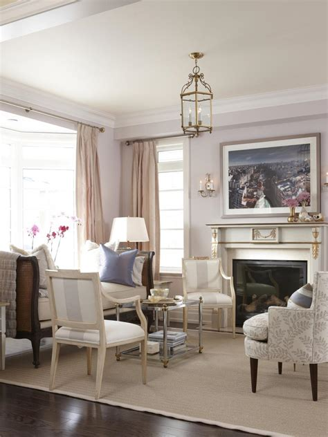 Glamorous Sitting Area With Gold-Accented Fireplace | HGTV